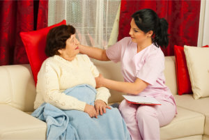 caregiver checking elderly woman's health